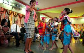 Michelle dances with children